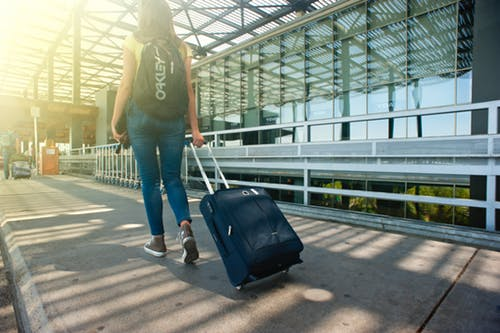 A girl pulling a suitcase at the airport